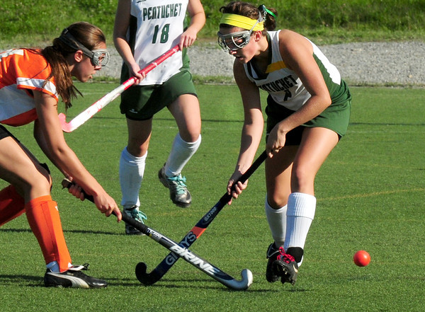 Amesbury: Pentucket's Carley Desjardins, right, gets the ball from Ipswich player Lisa Kaucher. Bryan Eaton/Staff Photo