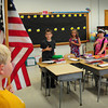 Newburyport: Noah Saboliauskas is the first one of the year to hold the American Flag in Deb Andrake's second grade class at the Bresnahan School as students recite the Pledge of Allegiance. It was the first day of school in Newburyport as well as Amesbury. Bryan Eaton/Staff Photo