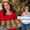 Newburyport: Opportunity Works participants Kaitlin Dower, left, and Grace Sullivan are ready for today's fundraising bake sale where they also unveil their new logo that Grace is holding. Bryan Eaton/Staff Photo