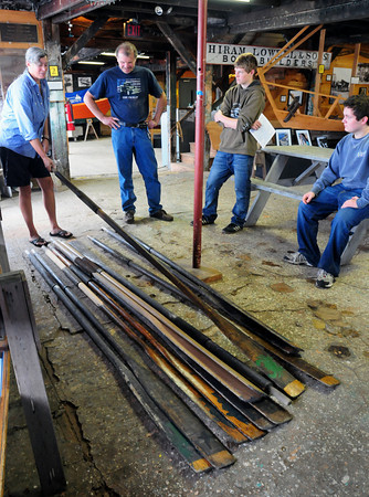 Amesbury: Alice Twombly of Lowell's Boat Shop in Amesbury gives a tour to John Fettig, Kyle Buckland and Tyler Palm from the Landmark School in Beverly during the Trails and Sails event-filled weekend. Tyler had interned at the boat shop over the summer. Bryan Eaton/Staff Photo