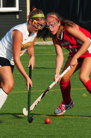 Amesbury: Newburyport's Molly Rowe, left, and Amesbury's Ali Debastis vie for control of the ball yesterday afternoon. Bryan Eaton/Staff Photo