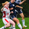 Amesbury: Amesbury's Natale Dawes moves past two Hamilton-Wenham defenders. Bryan Eaton/Staff Photo