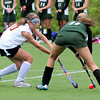 Amesbury: Newburyport's Emma Bartol, left, moves in on Pentucket's Charlotte Pope at the Amesbury Sports Park yesterday. Bryan Eaton/Staff Photo