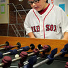 Salisbury: Riley Baker, 8, gets serious in a game of foosball with friends at the Boys and Girls Club on Tuesday afternoon before children headed to planned activities. The  Red Sox fan said he's sure his team will make the playoffs. Bryan Eaton/Staff Photo