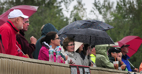 Amesbury: Fans of Newburyport and Pentucket High School's field hockey teams had umbrellas in hand as they watched the girls play at Amesbury Sports Park yesterday. Weather for the weekend is looking a lot nice, though a rough surf could be present from Hurrican Katia. Bryan Eaton/Staff Photo