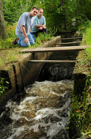 Byfield: Norm Rehn, left, and George Comiskey of the Parker River Clean Water Association at the fish ladder on the Parker River on Central Street in Byfield where alewive's are counted. Bryan Eaton/Staff Photo