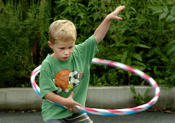 Newburyport: Alex Gross, 4, of Newburyport tries to manage two hula hoops at the YWCA on Thursday night. He was at the dedication of the labyrinth there located near the entrance. Bryan Eaton/Staff Photo