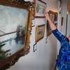 Newburyport: Cynthia Muir of the Custom House Maritime Museum notes differences and similarities on paintings and photographs of the Chain Bridge on which the museum is highlighting in a new exhibit. Bryan Eaton/Staff Photo
