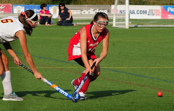 Amesbury: Newburyport's Molly Stanton moves the ball past Amesbury defensman Dylan Masi. Bryan Eaton/Staff Photo