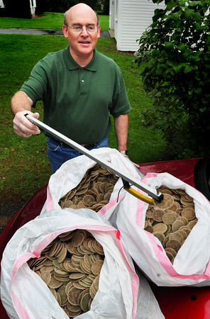 Merrimac: Greg Lyons of Merrimac has collected 12,000 of the sewage plant discs that inundated the Merrimack River several months ago. He collected them along the shoreline in West Newbury during walks at low tide. Bryan Eaton/Staff Photo