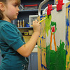 Rowley: Mackenzie Mitchell, 5, paints a colorful picture of herself Tuesday afternoon. She was in Melissa Gagnon's kindergarten class at the Pine Grove School in Rowley. Bryan Eaton/Staff Photo