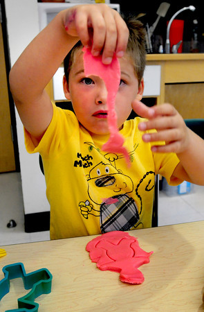 Salisbury: Alex Sauris, 4, pulls up Play-Dough from around a gingerbread man cutout at Salisbury Elementary School. He was Julie Deschene's pre-kindergarten class, which started Tuesday, at Salisbury Elementary School. Bryan Eaton/Staff Photo