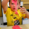 Salisbury: Alex Sauris, 4, pulls up Play-Dough from around a gingerbread man cutout at Salisbury Elementary School. He was Julie Deschene's pre-kindergarten class, which started Tuesday, at Salisbury Elementary School. Bryan Eaton/Staff Photo