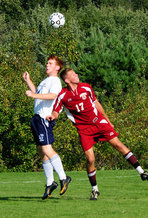 Byfield: Triton's Matt Kelly and Newburyport's Alec MacDougall head the ball in soccer action yesterday afternoon. Bryan Eaton/Staff Photo