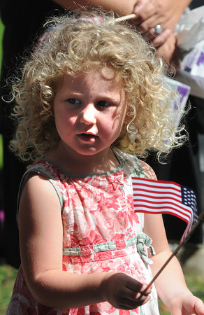 Newburyport: Niamh Cummings, 3, wave the flag at the Field of Honor Dedication Sunday at the Bartlet Mall. Jim Vaiknoras/Staff photo