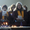 Amesbury: The choir sings as candles lit in rememberance of the victims of the Sept 11 attacts burn at a prayer service at the Main Street Congregational Church in Amesbury Sunday morning. Jim Vaiknoras/Staff photo