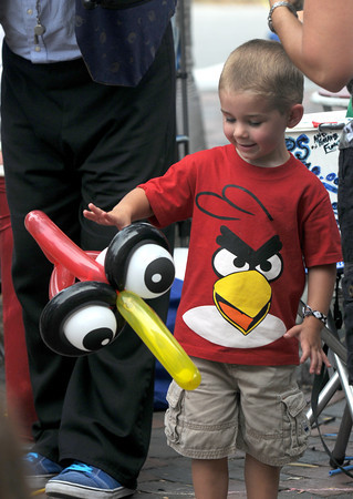 Newburyport: Aiden Van Twuyver, 3, of Georgetown plays with an Angry Bird balloon while dressed in his Angry Birds tee shirt. He got the balloon at the Newburyport Labor Day in Market Square.Jim Vaiknoras/Staff photo