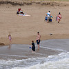 Newbury: People swim at the Newbury section of Plum Island Sunday morning. The Newburyport section just to the north remains closed due to high bacteria levels. Jim Vaiknoras/Staff photo