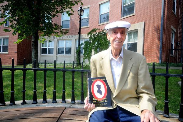 "Newburyport: John Lagoulis poses with his book"" Newburyport: As I Lived It!"" in front of teh Newburyport Library. Jim Vaiknoras/Staff photo"