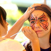 Amesbury: Anna Nash, 14 gets her face painted by Emily Shirshac at the Lucy Love Bus Fly Away Festival at Woodsom Farm Saturday. The event raises money to fund intergrated treatments for childen with cancer. Jim Vaiknoras/Staff photo