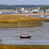 Newbury: A sail boat sits at low tide Sunday morning in the Plum Island Basin. JIm Vaiknoras/Staff photo