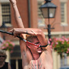 Newburyport:  Street performer Alakazam passes his body through a squash racket at teh Labor Day Festival in Market Square in Newburyport Monday. Jim Vaiknoras/Staff photo