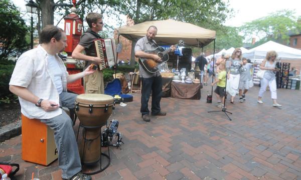 Newburyport: The Phil Henry Band performs on Inn Street at the Newburyport Labor Day Festival Sunday. Jim Vaiknoras/Staff photo