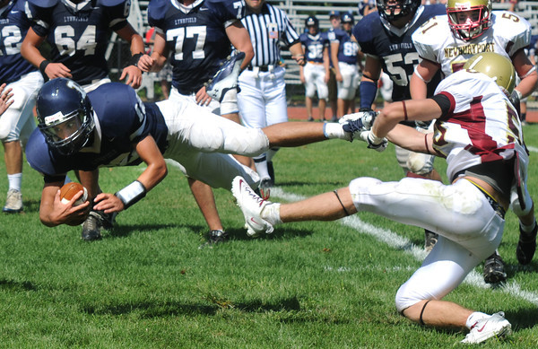 Lynnfield: Newburyport'sTrevor Pluck makes a shoestring tackle on Lynnfield quarterback Michael Karavetsos during their game at Lynnfield Saturday. Jim Vaiknoras/Staff photo