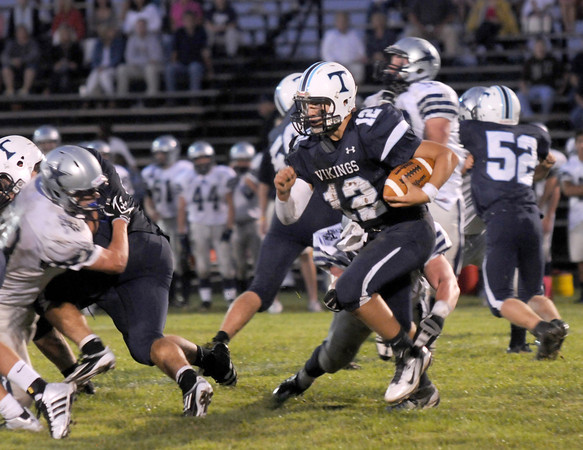 Byfield: Triton's Blaise Whitman runs a bootleg against Hamilton-Wenham Friday night at Triton. Jim Vaiknoras/Staff photo