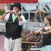 Newburyport: Silja Steinmann, 11, of Newburyport helps out magician Joe Howard in Market Square at the Newburyport Labor Day Festival. Jim Vaiknoras/Staff photo