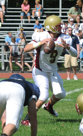 Lynnfield: Newburyport quarterback Connor Wile looks for a reciever during the Clippers game at Lynnfield Saturday. Jim Vaiknoras/Staff photo