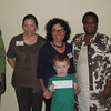 It was a special day for the Rowley Public Library and its patrons, especially the children, who have been reading books to benefit the adopt a library fund.  Inspired by a program launched by the American Library Association, the Rowley Library set a goal to raise $500 for the Centre Culturel Pyepoudre in Port-au-Prince, Haiti  which was devastated in the massive earthquake in 2010.  The Friends of the Library agreed to provide the funding last spring to make the event possible and both the adult and child readers took to the challenge with gusto.    <br /> <br /> The library staff wishes to thank all of the patrons who participated. Thanks to their enthusiastic support, Friends President Nancy Judge presented a check for $600 on Sept. 7, to Dr. Em Claire Knowles, assistant dean for Student Services at the Graduate School of Library and Information Science at Simmons College.  She accepted the donation on behalf of the ALA. Knowles