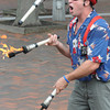 Newburyport: Brian Christie of Tewksbury juggles flaming batons on Inn Street in Newburyport Sunday at the Newburyport Labor Day Festival. Jim Vaiknoras/Staff photo