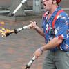 Newburyport: Brian Christie of Tewksbury juggles flaming batons on Inn Street in Newburyport Sunday at the Newburyport Labor Day Festival. Jim Vaiknoras/Staff photo