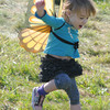 Amesbury: Autumn Anastasia, 2, dances in her butterfly wings at the Lucy Love Bus Fly Away Festival at Woodsom Farm Saturday. The event raises money to fund intergrated treatments for childen with cancer. Jim Vaiknoras/Staff photo