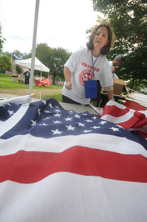 Newburyport:Volunteer Diann May prepares flags for the Field of Honor on the Bartlett Mall in Newburyport. The event will feature 500 flags covering the north side of the mall commemorating the attack of Sept 11 2001.JIm Vaiknoras/staff photo