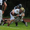 Lynnfield: Newburyport's Brett Fontaine is tackle by Lynnfield'sTyler Palumbo during their game Saturday at Lynnfield. Jim Vaiknoras/Staff photo