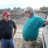 Seabrook: Edward O'Connell of the Army Corp of Engineers talks with Ron Barrett of Plum Island during a tour of an area in Seabrook where fill removed during the construction of the Seabrook power plant was dump. Barrett is hoping the large rocks can be used to repair the jetti on Plum Island. Jim Vaiknoras/Staff photo