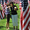 Newburyport:Jean Zabroski and her daughter Alexandra, 10 look through the more than 500 flags on display at 2nd annual Field of Honor at the Bartlett Mall Sunday during a ceremony honoring those killed on Sept 11, 2001, military personal, first responders, and our perfonal heroes. Jim Vaiknoras/Staff photo