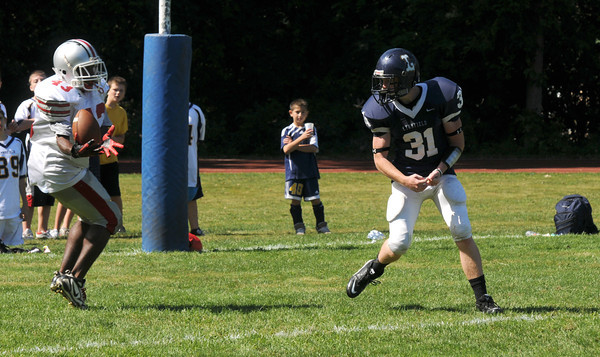 Lynnfield: Amesbury's Dalante Castle picks off a pass in the endzone at Lynnfield Saturday. The pass went off Lynnfield Ashwell near the end of the first half. JIm Vaiknoras/Staff photo