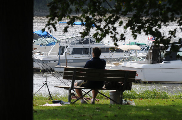 Amesbury: A fisherman sits in the shade in Alliance Park in Amesbury Sunday afternoon. Jim Vaiknoras/Staff photo