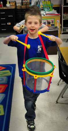 Amesbury: Dale Kosakoski, 5, bangs the drums while marching in a parade around his classroom with fellow students playing different instruments in Florence Emerson's class at the Cashman School in Amesbury. The children were about musical instruments and the concept of tempo. Bryan Eaton/Staff Photo