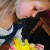 Newburyport: Elizabeth Bolke, 6, attaches hair to the flower fairy at the Kelley School Teen Center on Tuesday. Several special events are happening through Newburyport Youth Services during April vacation week, including this one taught by Elizabeth Rush. Bryan Eaton/Staff Photo