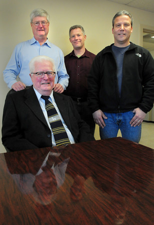 Newburyport: Hero Coating founder Robert Lynch with sons, Steve, left, David, center, and general manager Gerry Fortier. Bryan Eaton/Staff Photo