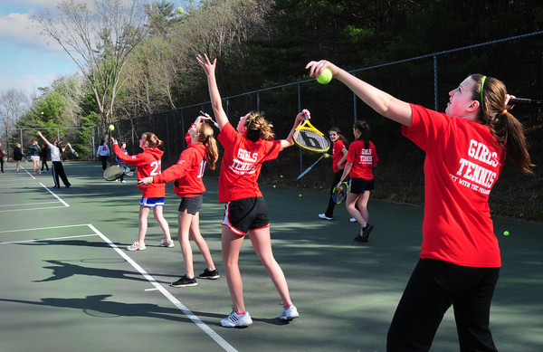 Amesbury: The Amesbury High girls tennis team practice serving yesterday afternoon. Bryan Eaton/Staff Photo