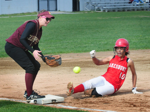 Amesbury: Amesbury's Alexis Boswell makes a safe slide to third as the Clipper's Leah Tomasz misses the throw. Bryan Eaton/Staff Photo