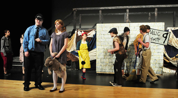 "Amesbury: The cast of ""Urinetown"" in production at Amesbury High School starts the opening scene during a rehearsal. Bryan Eaton/Staff Photo"