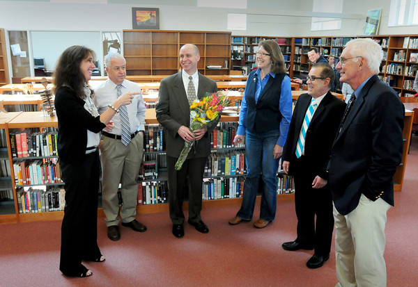 Newburyport: The Institution For Savings made a donation to the Newburyport Education Foundation for the Newburyport High School library yesterday afternoon. President Michael Jones, center, received flowers from libary media specialist Lynne Cote, left, on a tour of the facility. Also present, principal Mike Parent; Cindy Johnson, NEF officer; school superintedent Marc Kerble and former principal and NEF president John Elwell. Bryan Eaton/Staff Photo