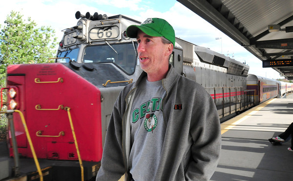 "Newburyport: Bob Power of Everett talks about the fare increase as the commuter train pulls into the Newburyport Station yesterday afternoon. The 26 year employee of Berkshire Manufacturing in Newburyport's industrial park says about the MBTA ""We're at their mercy."" Bryan Eaton/Staff Photo"