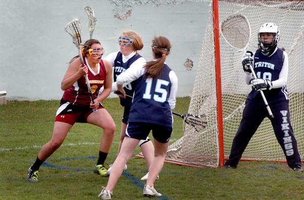 Newburyport: Newburyport's Meri Adsit faces Triton defenders as she looks to score. Bryan Eaton/Staff Photo